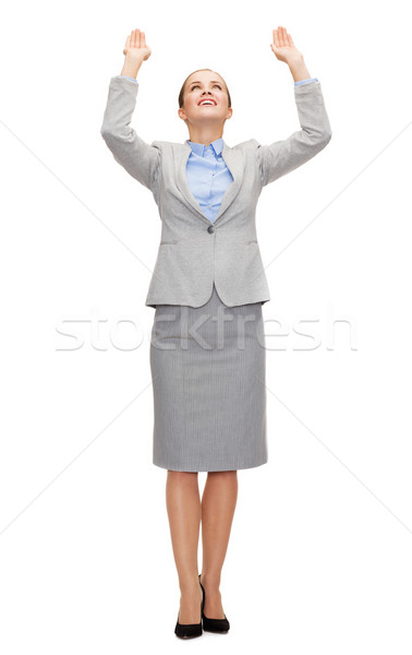 businesswoman pushing up something imaginary Stock photo © dolgachov