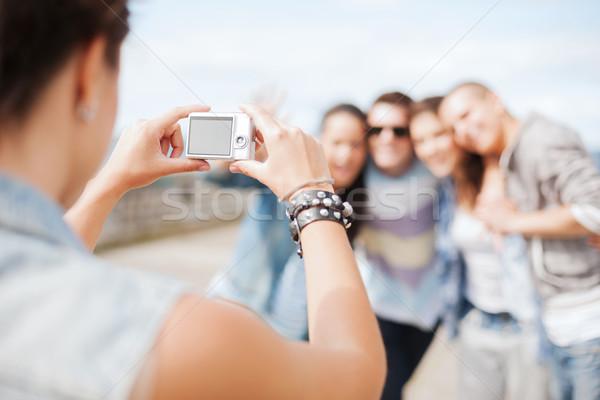 Femminile mani fotocamera digitale estate Foto d'archivio © dolgachov