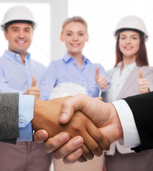 Zakenman zakenvrouw handen schudden business kantoor handen Stockfoto © dolgachov