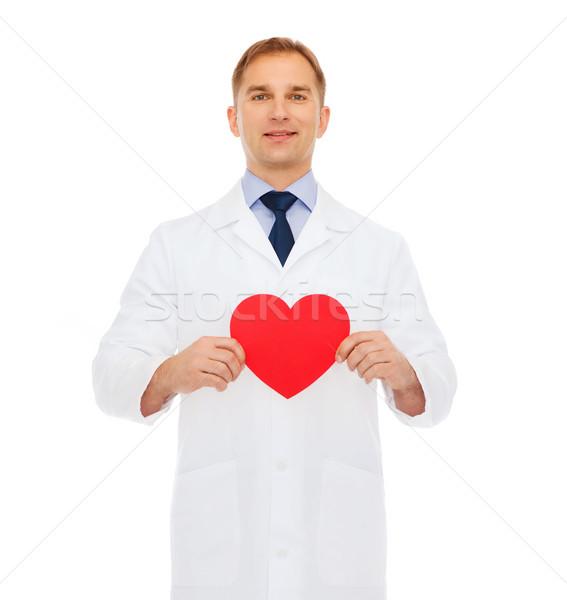 Uśmiechnięty mężczyzna lekarz czerwony serca opieki zdrowotnej muzyka Zdjęcia stock © dolgachov