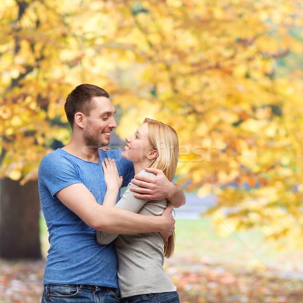 Glimlachend paar naar ander liefde Stockfoto © dolgachov