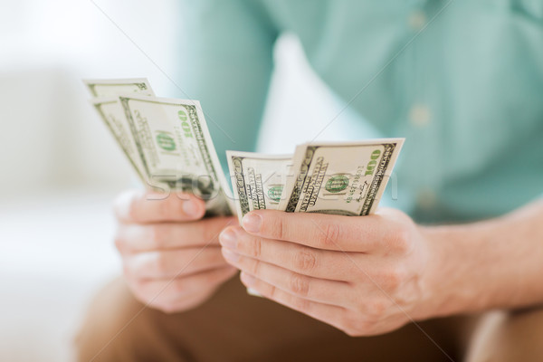 Stock photo: close up of man counting money at home