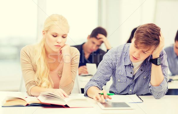 Zmęczony studentów książek notebooki edukacji Zdjęcia stock © dolgachov
