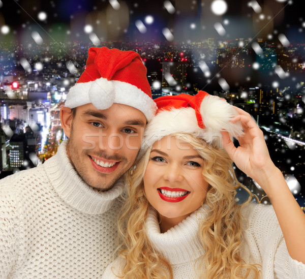 smiiling couple in sweaters and santa helper hats Stock photo © dolgachov
