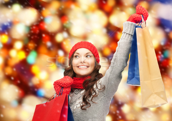asian woman in winter clothes with shopping bags Stock photo © dolgachov