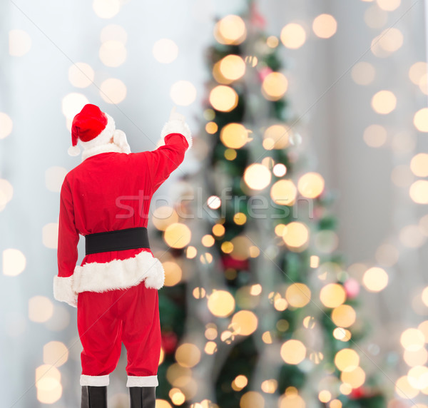Man kostuum kerstman christmas vakantie mensen Stockfoto © dolgachov