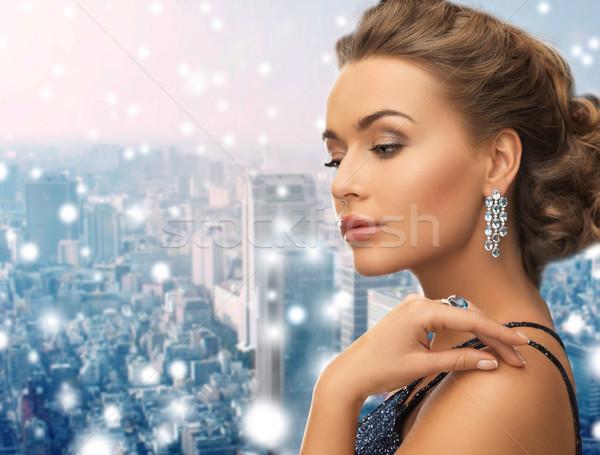 beautiful woman wearing ring and earrings Stock photo © dolgachov