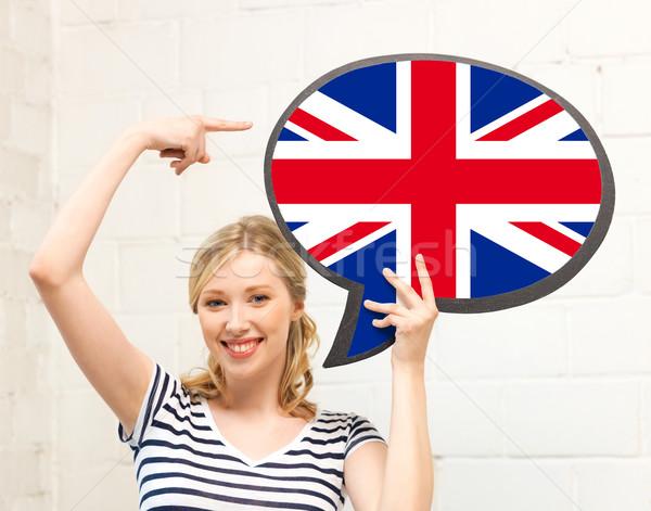 Stok fotoğraf: Gülümseyen · kadın · metin · kabarcık · İngiliz · bayrağı · eğitim · yabancı