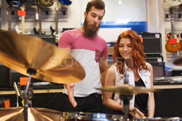 Férfi nő dob készlet zene bolt Stock fotó © dolgachov