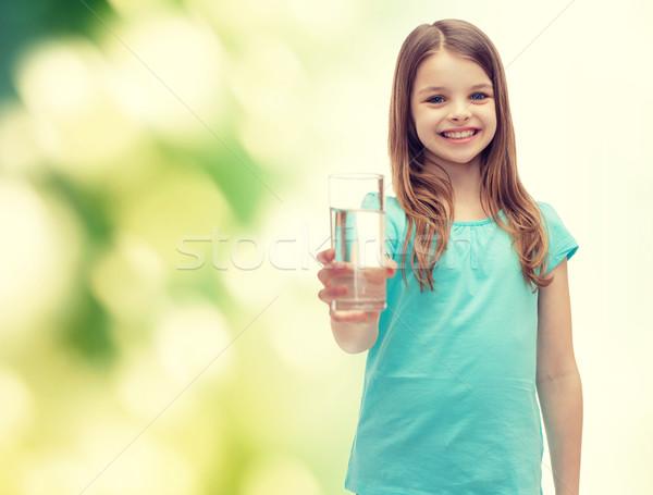 Glimlachend meisje glas water gezondheid schoonheid Stockfoto © dolgachov