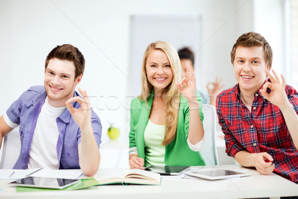 students with tablet pcs showing ok sign Stock photo © dolgachov