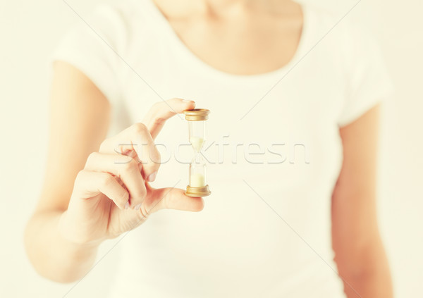 woman with hourglass Stock photo © dolgachov