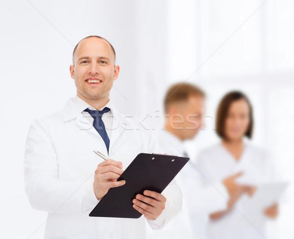 Stok fotoğraf: Gülen · erkek · doktor · tıp · meslek · takım · çalışması