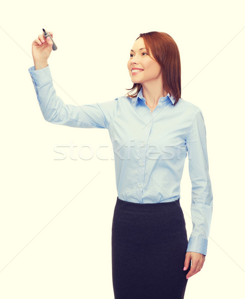 businesswoman writing something in air with marker Stock photo © dolgachov