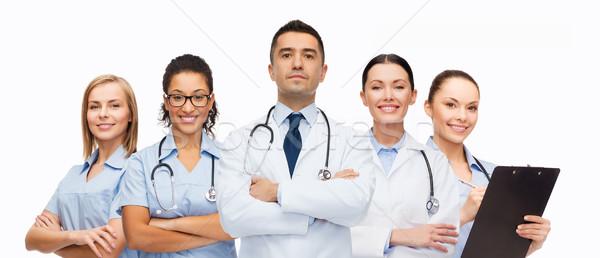 Grupy opieki zdrowotnej zawód ludzi muzyka kobiet Zdjęcia stock © dolgachov