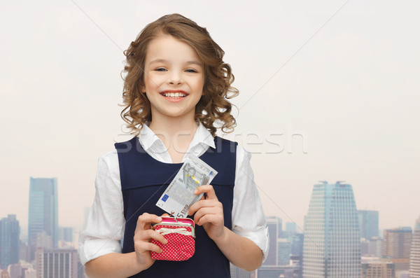 happy girl with purse and paper money Stock photo © dolgachov