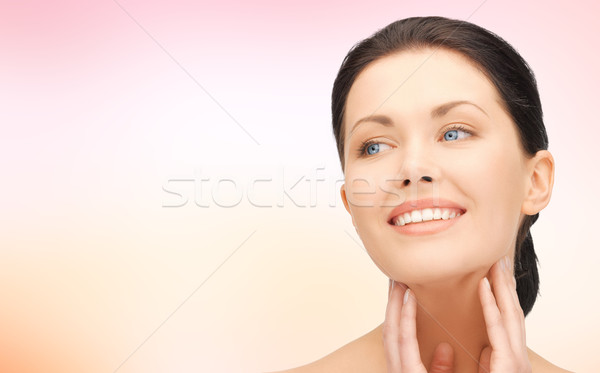 beautiful young woman touching her face and neck Stock photo © dolgachov