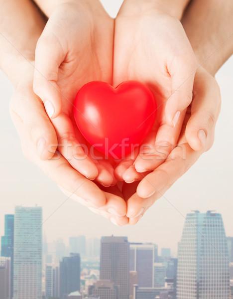 Casal mãos vermelho coração Foto stock © dolgachov