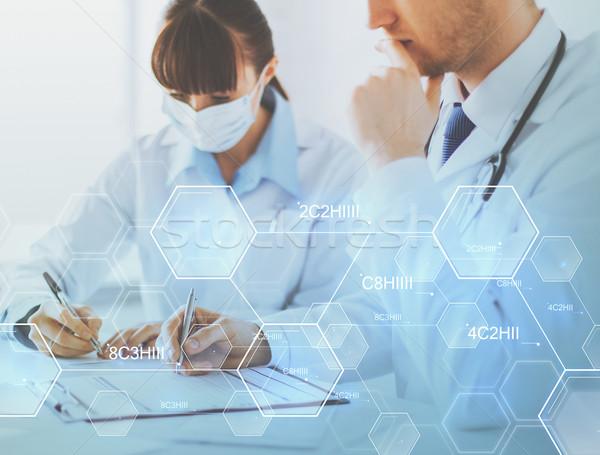 doctor and nurse writing chemical analysis report Stock photo © dolgachov