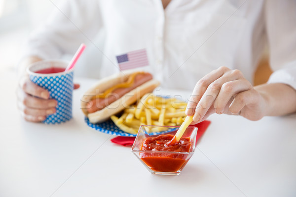 close up of woman eating on american food Stock photo © dolgachov