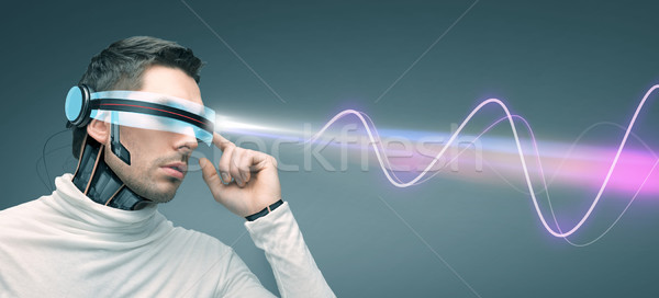 man with futuristic 3d glasses and sensors Stock photo © dolgachov