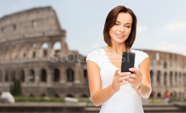 woman taking selfie with smartphone over coliseum Stock photo © dolgachov