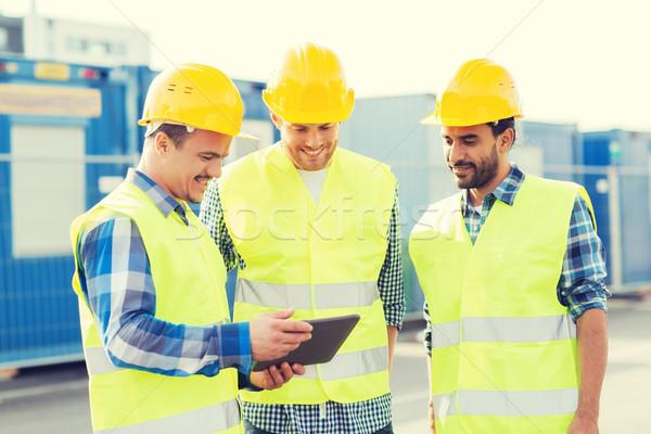 Sonriendo constructores negocios edificio trabajo en equipo Foto stock © dolgachov
