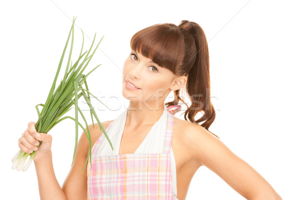 beautiful housewife with spring onions over white Stock photo © dolgachov