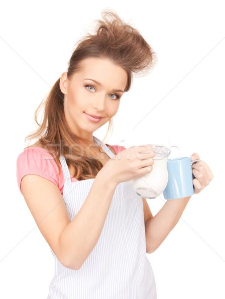 housewife with milk and mug Stock photo © dolgachov