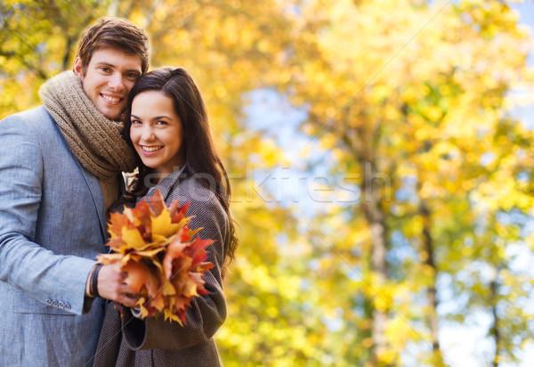 smiling couple hugging over autumn background Stock photo © dolgachov