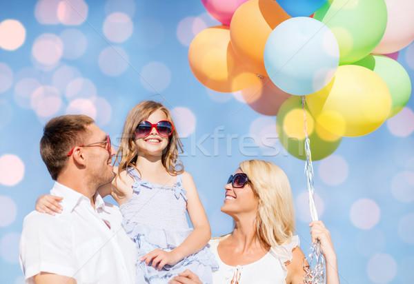 Boldog család léggömbök kék fények nyár ünnepek Stock fotó © dolgachov