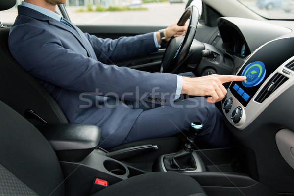 close up of man  driving car in eco mode Stock photo © dolgachov