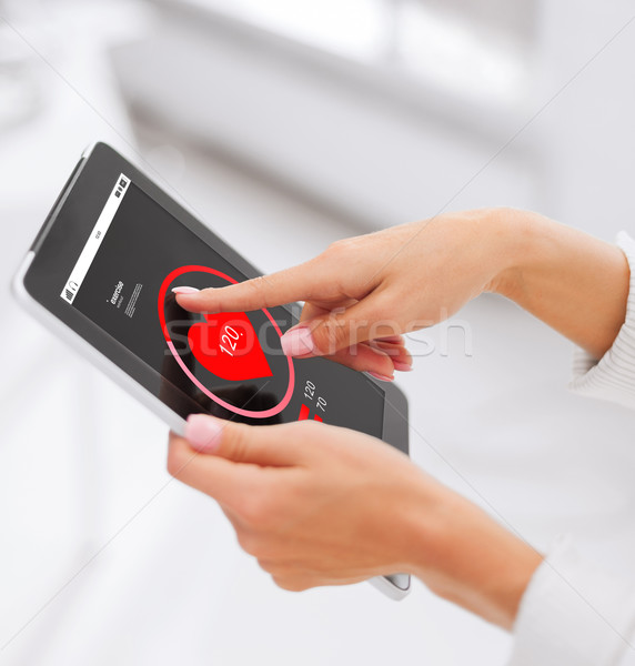 close up of hands with heart icon on tablet pc Stock photo © dolgachov
