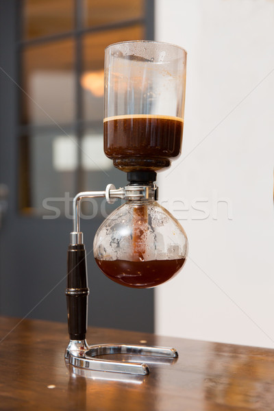 close up of siphon vacuum coffee maker at shop Stock photo © dolgachov