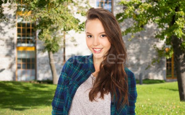 happy teenage student girl over campus  Stock photo © dolgachov