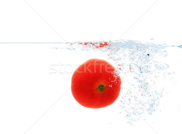 tomato falling or dipping in water with splash Stock photo © dolgachov