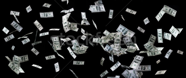 close up of us dollar money flying over black Stock photo © dolgachov