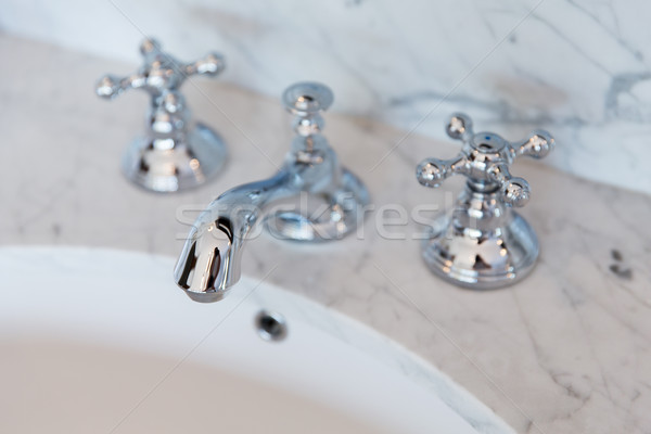 close up of bath tap or faucet at bathroom Stock photo © dolgachov