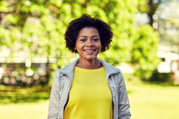 happy african american young woman in summer park Stock photo © dolgachov