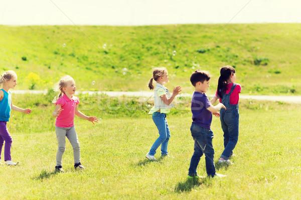 Grup çocuklar sabun köpüğü açık havada yaz çocukluk Stok fotoğraf © dolgachov