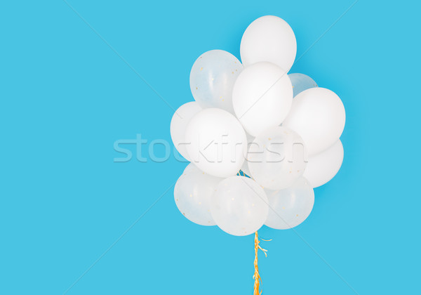 close up of white helium balloons over blue Stock photo © dolgachov