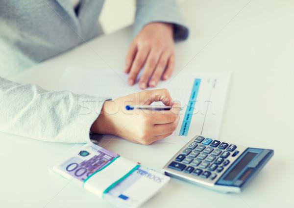 手 お金 電卓 ビジネス 金融 ストックフォト © dolgachov