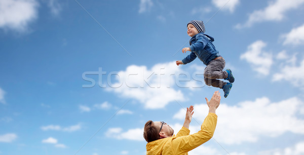 father with son playing and having fun outdoors Stock photo © dolgachov