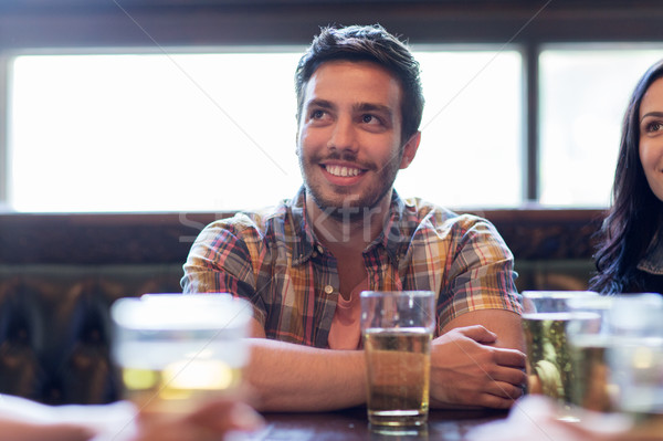 happy friends drinking beer at bar or pub Stock photo © dolgachov