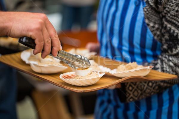 close up of scallop with garnish on seashell Stock photo © dolgachov