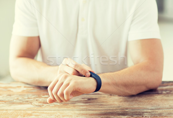 close up of man with heart-rate watch Stock photo © dolgachov