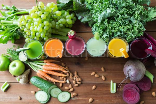 Szemüveg különböző gyümölcs zöldség egészséges étkezés italok Stock fotó © dolgachov