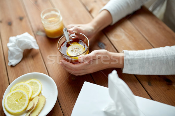 ill woman drinking tea with lemon and ginger Stock photo © dolgachov