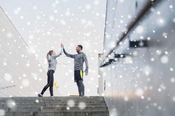 couple of sportsmen making high five outdoors Stock photo © dolgachov