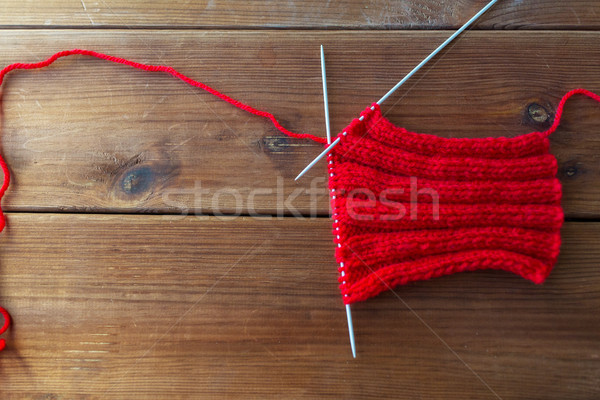 hand-knitted item with knitting needles on wood Stock photo © dolgachov
